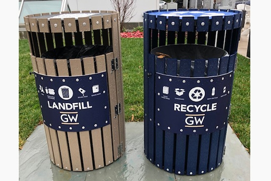 The new recycling and trash containers that are buff and blue